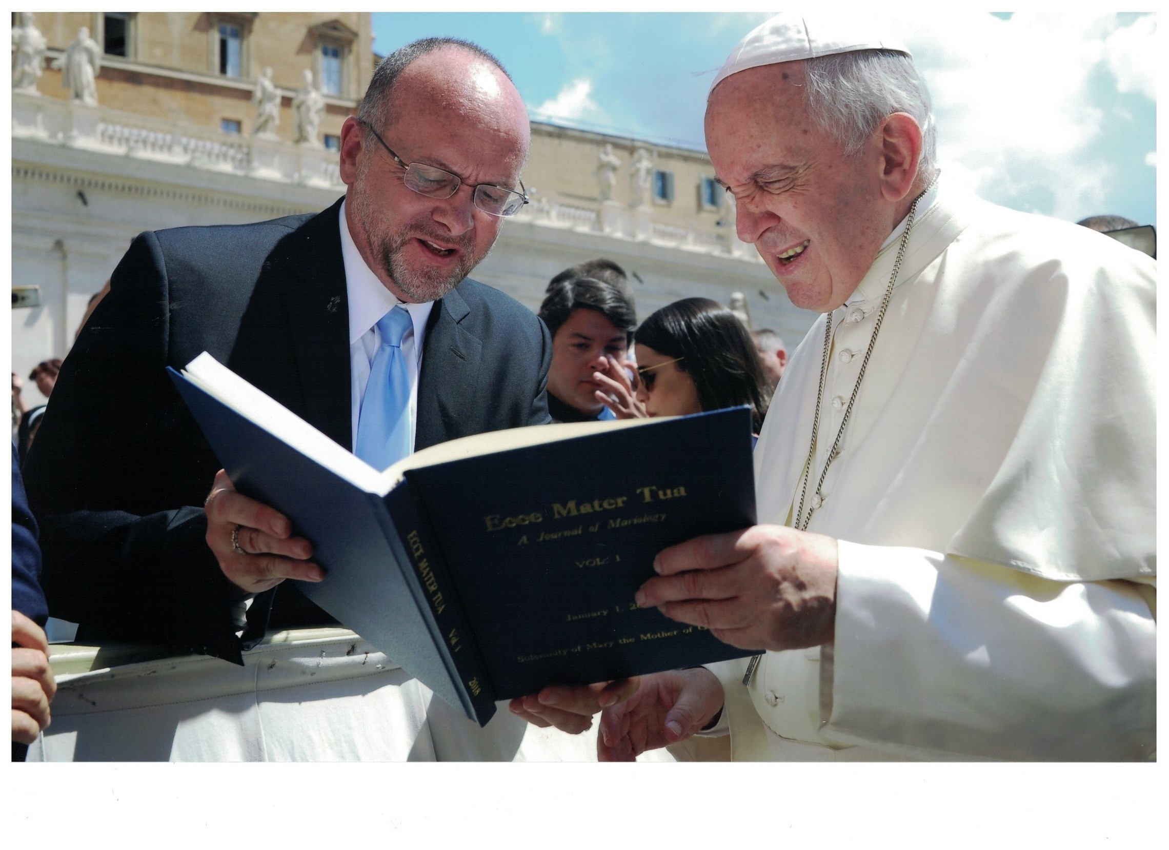Dr. Mark Miravalle, President of the IMA, presenting hard bound volume of Ecce Mater Tua to Pope Francis